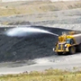 A Water Cart Spraying RST's RT5 Superskin onto a Coal Stockpile